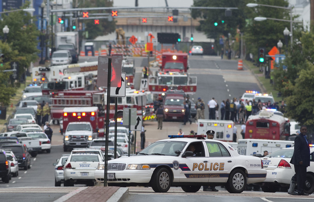 ". Police and firefighters respond to the report of a shooting at the Navy Yard in Washington, DC, September 16, 2013.  A gunman shot and wounded at least one person Monday in a headquarters building at the US Navy Yard in Washington and is still at large, the navy said.""There is one confirmed injury. Emergency personnel are on scene and a \'shelter in place\' order has been issued for Navy Yard personnel,\"" the navy said in a statement. Local television reported that there were as many as five casualties and the Navy said that police had entered building number 197 in search of the shooter. The Navy said at least three shots were fired at 8:20 am (1320 GMT) in the headquarters building of the Naval Sea Systems Command.   SAUL LOEB/AFP/Getty Images"