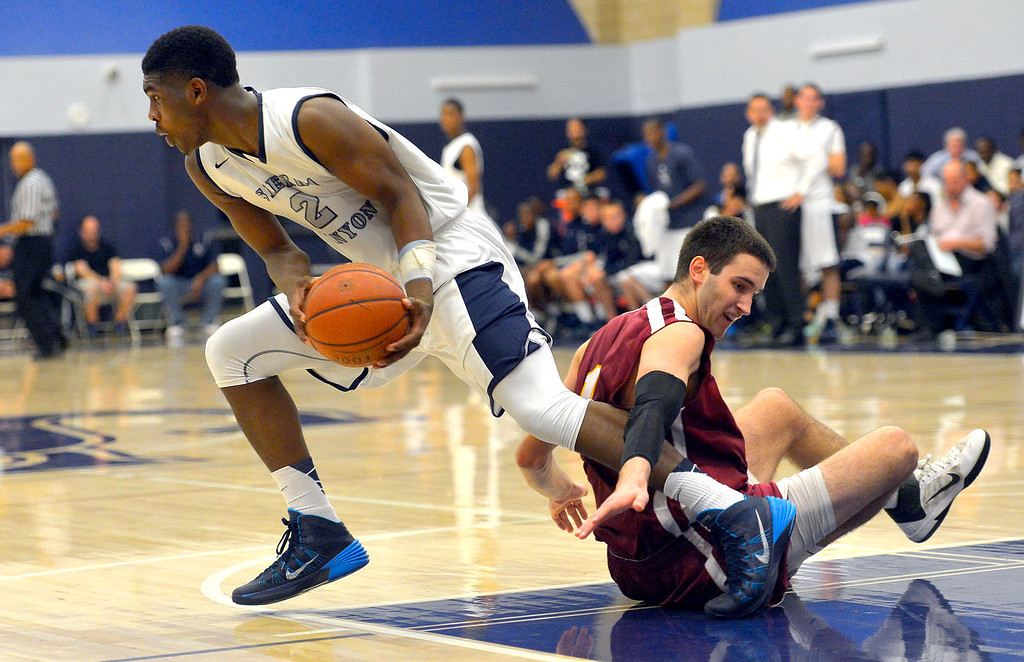 . Sierra Canyon\'s Cody Riley is fouled by Cantwell-Sacred Heart\'s Balsa Dragovic late in the game during their Division IV state regional semifinal game in Chatsworth, CA March 18, 2014.(Andy Holzman/Los Angeles Daily News)