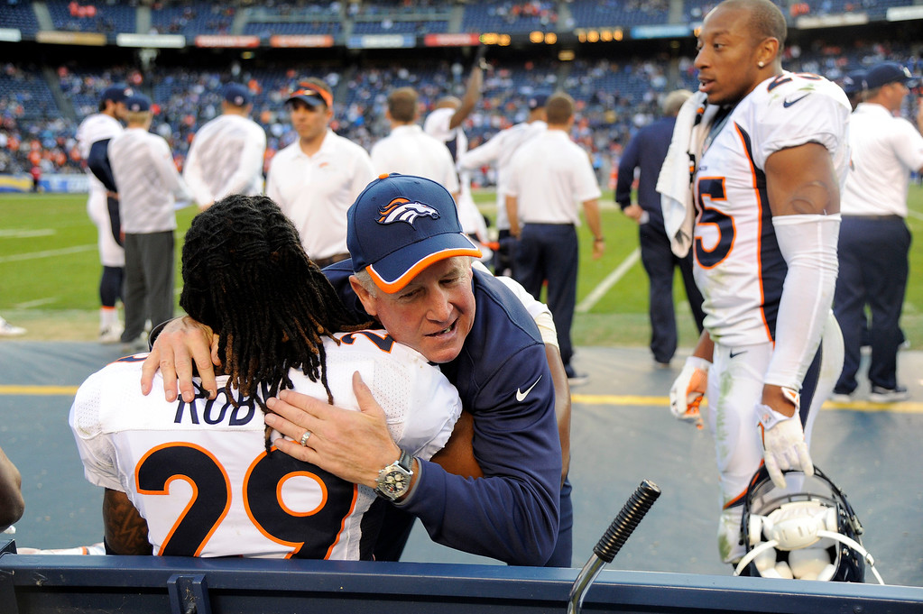 . SAN DIEGO, CA - DECEMBER 14: Denver Broncos head coach John Fox hugs Denver Broncos cornerback Bradley Roby (29) on the bench with seconds left int he game December 14, 2014 at Qualcomm Stadium. The Denver Broncos defeated the San Diego Chargers 22-10 for their fourth straight AFC title.  (Photo By John Leyba/The Denver Post)