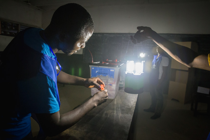 Monrovia, Liberia October 10, 2017 - Polling station workers identify and cut ballot box seals after sunset on election day.