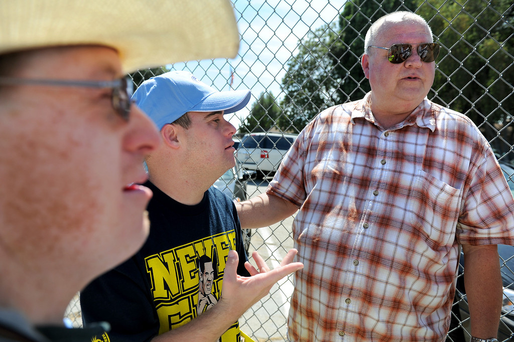 . Tom Williamson, right, with his son Blair Williamson, center, and Ryan Davis picket LAUSD board member Tamar Galatzan in Lake Balboa, Wednesday, July 24, 2013. Parents and Teachers United for Action picketed to voice their opposition to the district�s transitioning of special education students onto regular education campuses. (Michael Owen Baker/L.A. Daily News)