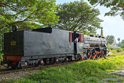 Class YC  4-6-2 No 629 backs onto its passenger train at Pa Ya Gyi with pagoda in the background