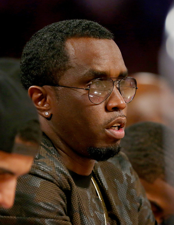 . NEW ORLEANS, LA - FEBRUARY 15:  Sean Combs attends the Foot Locker Three-Point Contest 2014 as part of the 2014 NBA All-Star Weekend at the Smoothie King Center on February 15, 2014 in New Orleans, Louisiana. (Photo by Ronald Martinez/Getty Images)
