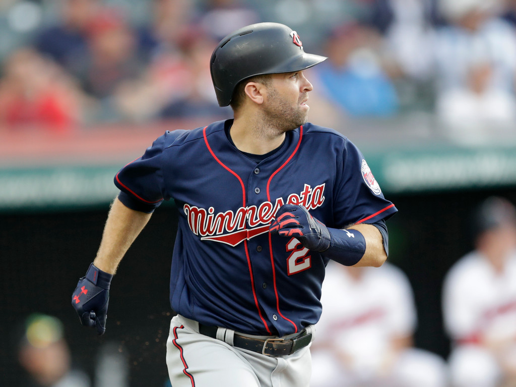 . Minnesota Twins\' Brian Dozier watches his ball after hitting a two-run home run off Cleveland Indians starting pitcher Corey Kluber in the fourth inning of a baseball game, Friday, June 15, 2018, in Cleveland. Logan Morrison scored on the play. (AP Photo/Tony Dejak)