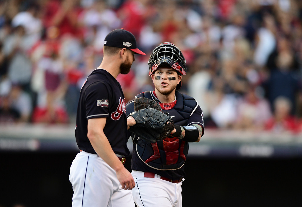 . Cleveland Indians catcher Roberto Perez, right, talks with pitcher Corey Kluber during Game 2 of baseball\'s American League Division Series against the Boston Red Sox, Friday, Oct. 7, 2016, in Cleveland. (AP Photo/David Dermer)