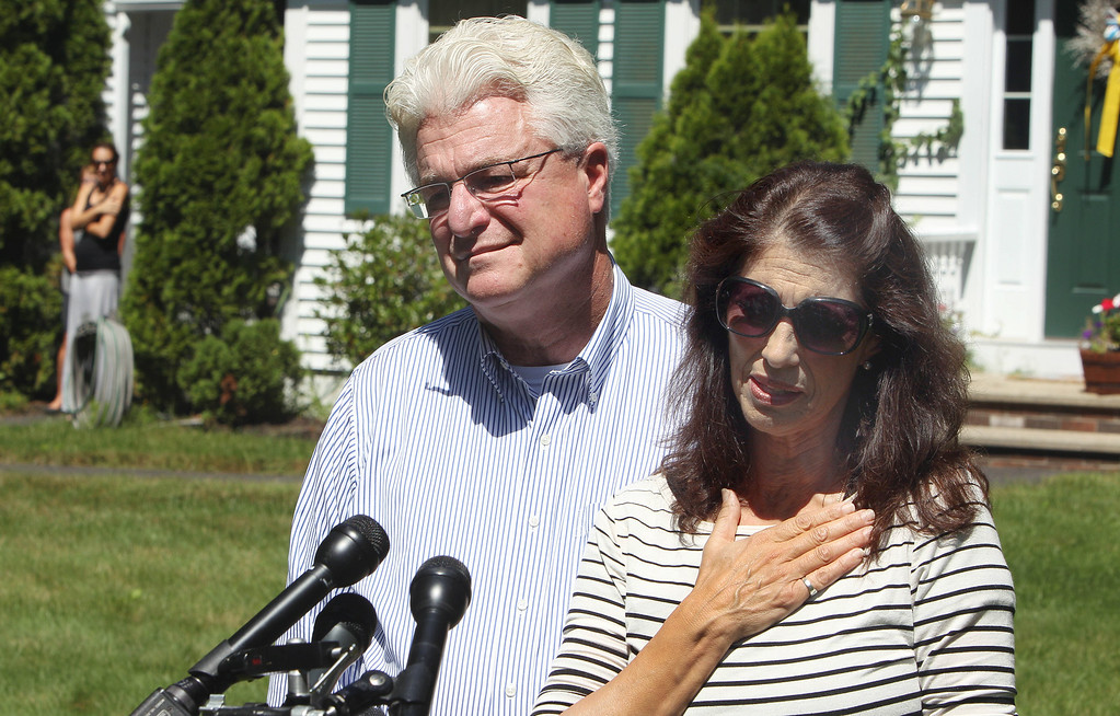 . Diane and John Foley talk to reporters after speaking with U.S. President Barack Obama Wednesday, Aug. 20, 2014 outside their home in Rochester, N.H.  Their son, James Foley was abducted in November 2012 while covering the Syrian conflict. Islamic militants posted a video showing his murder on Tuesday and said they killed him because the U.S. had launched airstrikes in northern Iraq.   (AP Photo/Jim Cole)