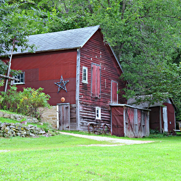 RED BARN WITH STAR ON HILL