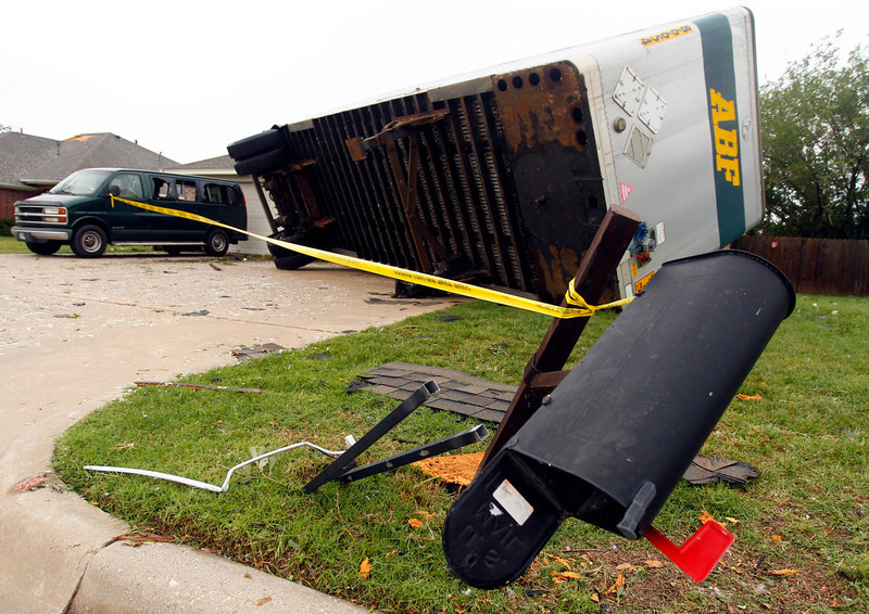 . A trailer blown into a home on Lindsay Lane in Cleburne rests on a car after a tornado touched down in Cleburne, Texas May 16, 2013. At least six people were killed and seven were missing after as many as 10 tornadoes ripped through north-central Texas Wednesday evening, leaving a trail of destruction from the worst severe storm outbreak in the United States so far this year.  REUTERS/Richard Rodriguez
