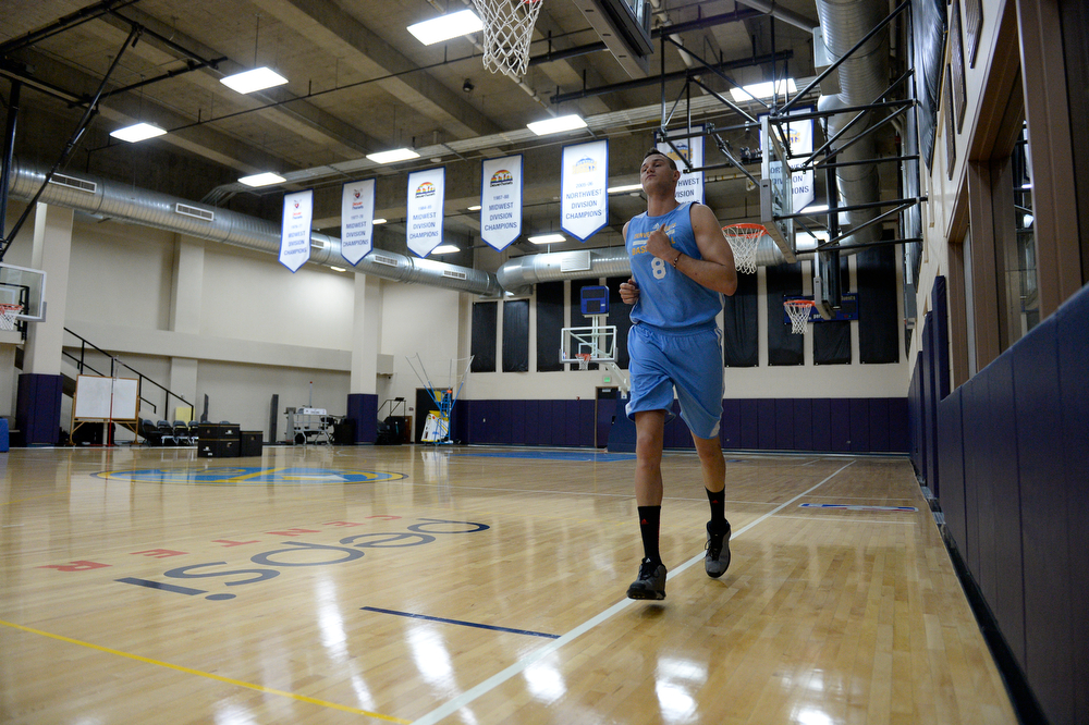 . Denver Nuggets Danilo Gallinari takes a lap around the court during his goes  workout with assistant coach/strength and conditioning Steve Hess May 27, 2014 at Pepsi Center. (Photo by John Leyba/The Denver Post)