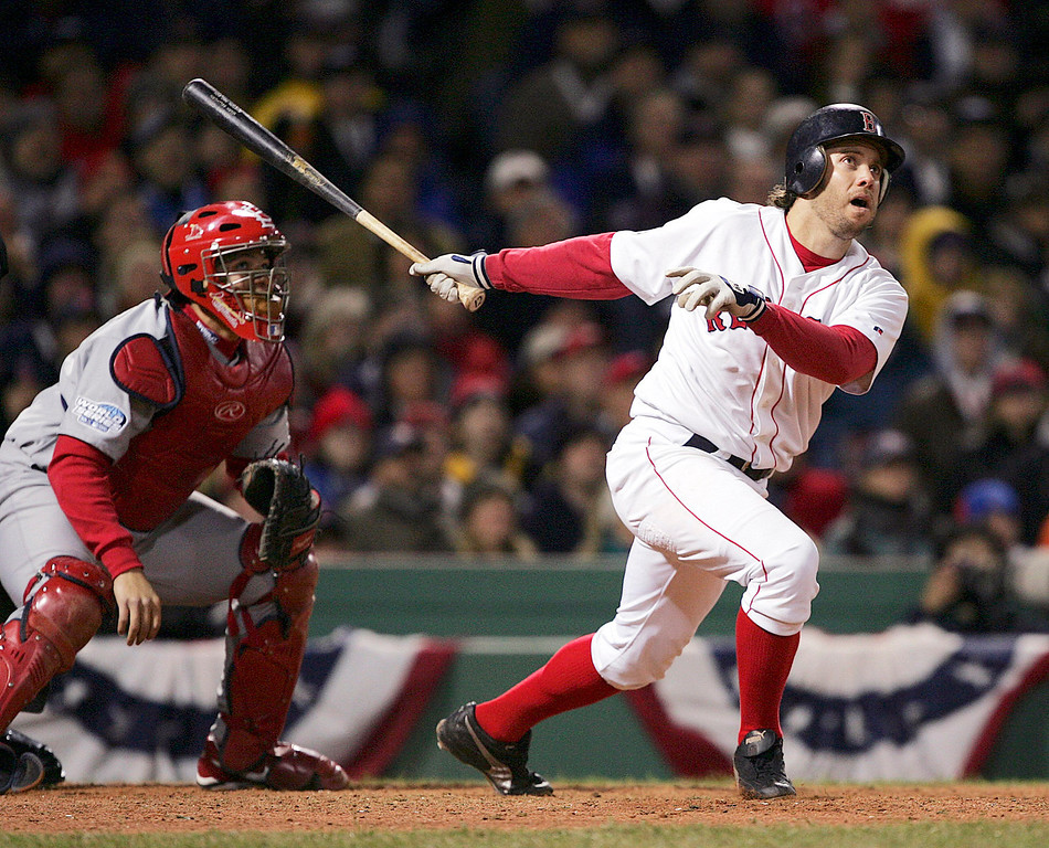 . Boston Red Sox\'  Mark Bellhorn hits an eighth- inning, two-run home run off St. Louis Cardinals\' Julian Tavarez in Game 1 of the World Series in Boston, Saturday, Oct. 23, 2004.   (AP Photo/Charles Krupa)