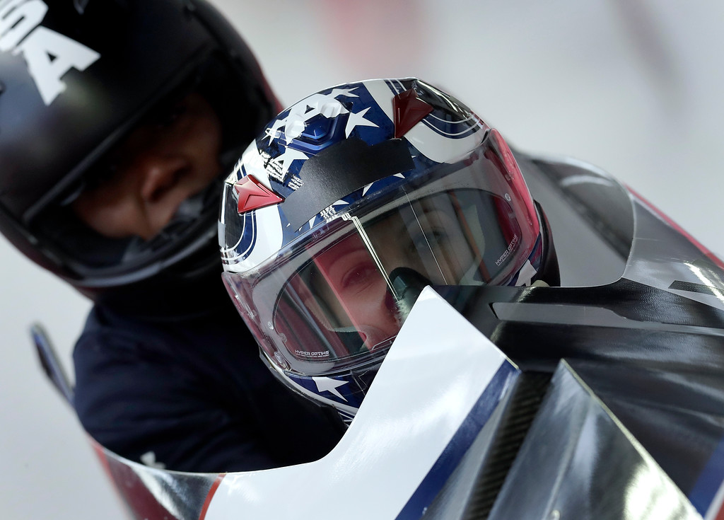 . Driver Jamie Greubel Poser and Aja Evans of the United States arrive at the finish area during a training run for the women\'s bobsled competition at the 2018 Winter Olympics in Pyeongchang, South Korea, Monday, Feb. 19, 2018. (AP Photo/Michael Sohn)