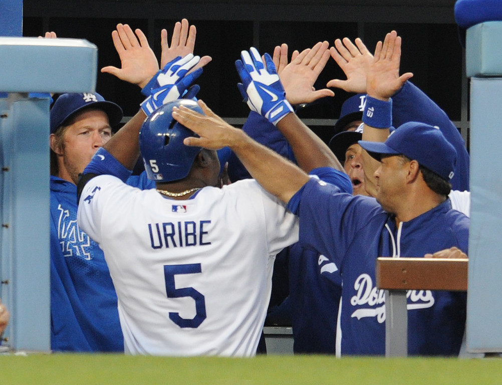 . Dodgers Juan Uribe is congratulated on his 2nd inning homer. The Dodgers played the NY Yankees in a game at Dodger Stadium in Los Angeles, CA. 7/30/2013(John McCoy/LA Daily News)