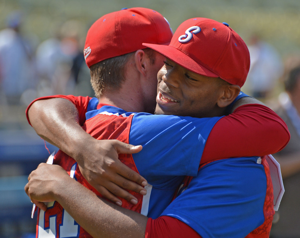 . Serra\'s Trent Hammond (21) and Dominic Smith (22) hug in celebration after beating Mira Costa in the CIF-SS Division III championship baseball game Friday at Dodger Stadium. Serra won the title, 8-1. Hammond, a transfer from Mira Costa, had numerous hits while Smith pitched the first six innings. 20130531 Photo by Steve McCrank / Staff Photographer