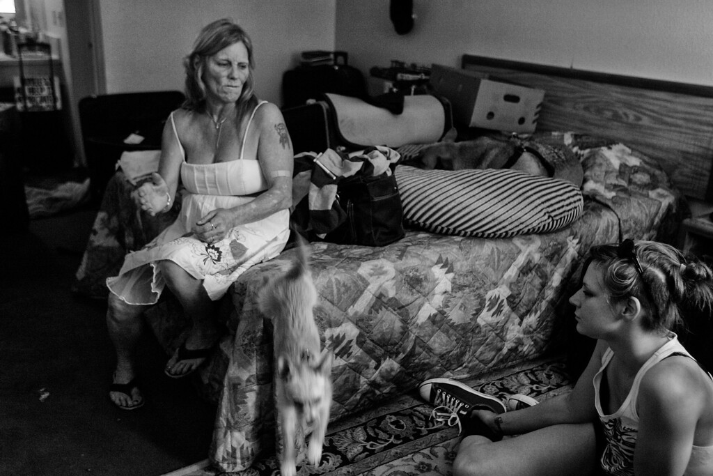 . Dorothy visits with Candice, who is homeless, and her dog Stella, who jumps off the bed.