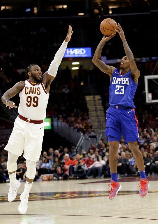 . Los Angeles Clippers\' Lou Williams (23) shoots over Cleveland Cavaliers\' Jae Crowder (99) in the second half of an NBA basketball game, Friday, Nov. 17, 2017, in Cleveland. The Cavaliers won 118-113 in overtime. (AP Photo/Tony Dejak)