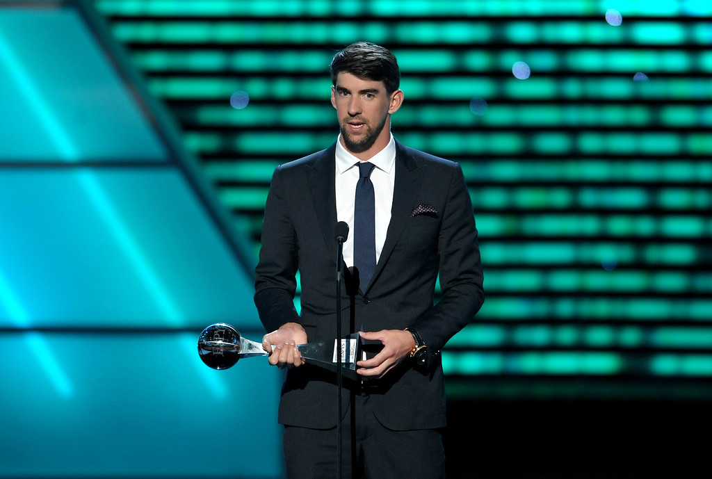 . Michael Phelps accepts the award for best record-breaking performance at the ESPY Awards on Wednesday, July 17, 2013, at Nokia Theater in Los Angeles. (Photo by John Shearer/Invision/AP)