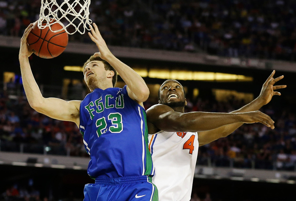 . Florida Gulf Coast\'s Eddie Murray (23) shoots against Florida\'s Patric Young (4)during the first half of a regional semifinal game in the NCAA college basketball tournament, Friday, March 29, 2013, in Arlington, Texas. (AP Photo/Tony Gutierrez)