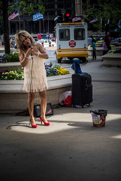 The street performer in red high heels