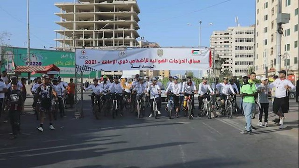 Disabled Palestinians participate in a bicycle race