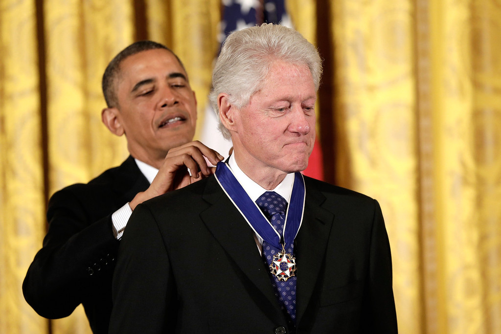. U.S. President Barack Obama awards the Presidential Medal of Freedom to former U.S. President Bill Clinton in the East Room at the White House on November 20, 2013 in Washington, DC.  (Photo by Win McNamee/Getty Images)