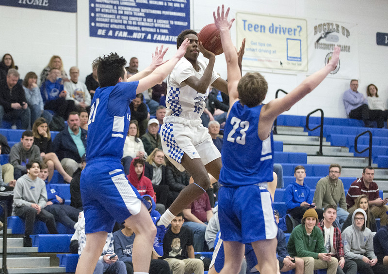 02/11/20   Wesley Bunnell | Staff  Plainville boys basketball at home on Tuesday night against Lewis Mills.  Omarion Miller (23).