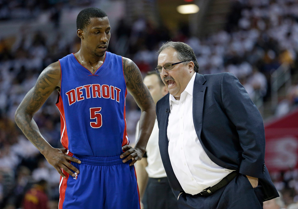. Detroit Pistons head coach Stan Van Gundy, right, talks with Kentavious Caldwell-Pope in the first half in Game 2 of a first-round NBA basketball playoff series, Wednesday, April 20, 2016, in Cleveland. The Cavaliers won 107-90. (AP Photo/Tony Dejak)