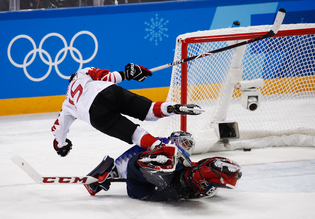 . Melodie Daoust (15), of Canada, scores against Goalie Maddie Rooney (35), of the United States, during the shootout in women\'s gold medal hockey game at the 2018 Winter Olympics in Gangneung, South Korea, Thursday, Feb. 22, 2018. (AP Photo/Jae C. Hong)