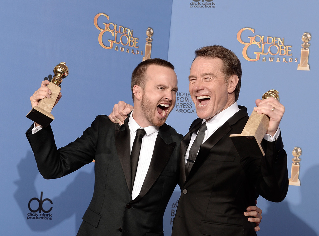 . Actors Aaron Paul (L) and Bryan Cranston, winners of Best Series - Drama for \'Breaking Bad,\' pose in the press room during the 71st Annual Golden Globe Awards held at The Beverly Hilton Hotel on January 12, 2014 in Beverly Hills, California.  (Photo by Kevin Winter/Getty Images)