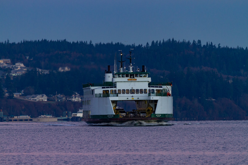 The Washington State Ferry M/V Kittitas is seen crossing from Clinton on Whidbey Island to Mukilteo under a colorful sunset sky