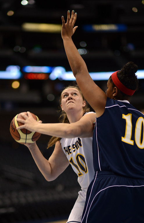 . DENVER, CO. - APRIL 06 : Kaylie Rader of Horizon High School (10), left, controls the ball against Blue team Francesca Sally of Denver East (10) during The Show, Colorado\'s High School All-Star game, at Pepsi Center. Denver, Colorado. April 6, 2013. Blue team won 59-51. (Photo By Hyoung Chang/The Denver Post)