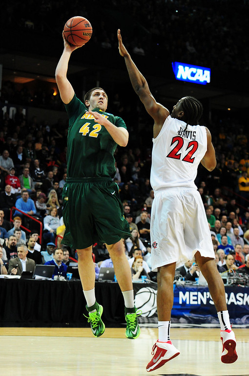 . Marshall Bjorklund #42 of the North Dakota State Bison shoots over Josh Davis #22 of the San Diego State Aztecs in the first half during the Third Round of the 2014 NCAA Basketball Tournament at Spokane Veterans Memorial Arena on March 22, 2014 in Spokane, Washington.  (Photo by Steve Dykes/Getty Images)