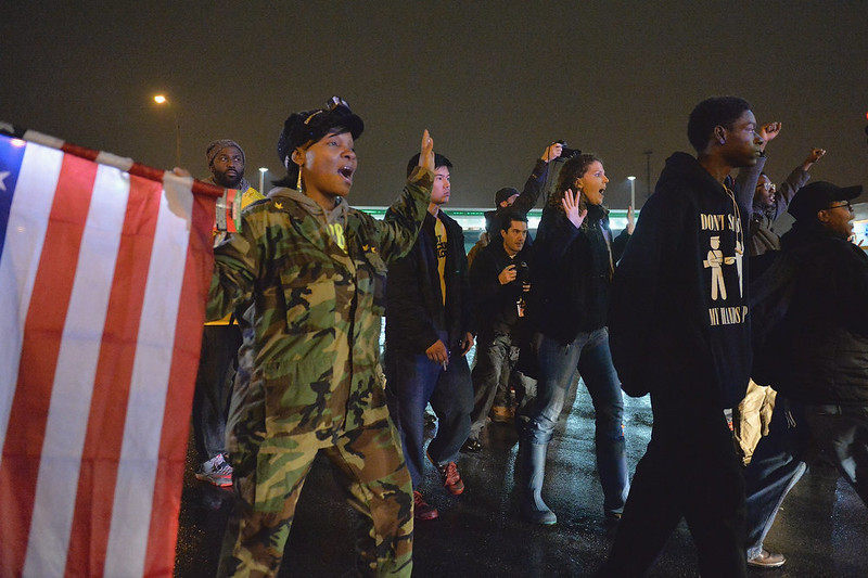 . Demonstrators protest and block traffic as they take to the streets as a show of civil disobedience in the Shaw neighborhood of St. Louis, Missouri on November 23, 2014.  Police erected barricades and businesses were boarded up November 23, 2014 as the clock ticked down to a grand jury decision on whether to indict a white officer for shooting dead an unarmed black teenager.   Michael B. Thomas/AFP/Getty Images