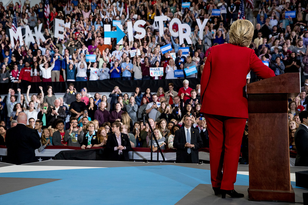 . Democratic presidential candidate Hillary Clinton pauses while speaking at a midnight rally at Reynolds Coliseum at North Carolina State University in Raleigh, N.C., Tuesday, Nov. 8, 2016. (AP Photo/Andrew Harnik)