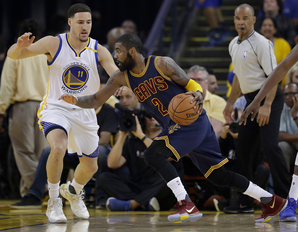 . Cleveland Cavaliers guard Kyrie Irving (2) drives against Golden State Warriors guard Klay Thompson (11) during the first half of Game 1 of basketball\'s NBA Finals in Oakland, Calif., Thursday, June 1, 2017. (AP Photo/Marcio Jose Sanchez)