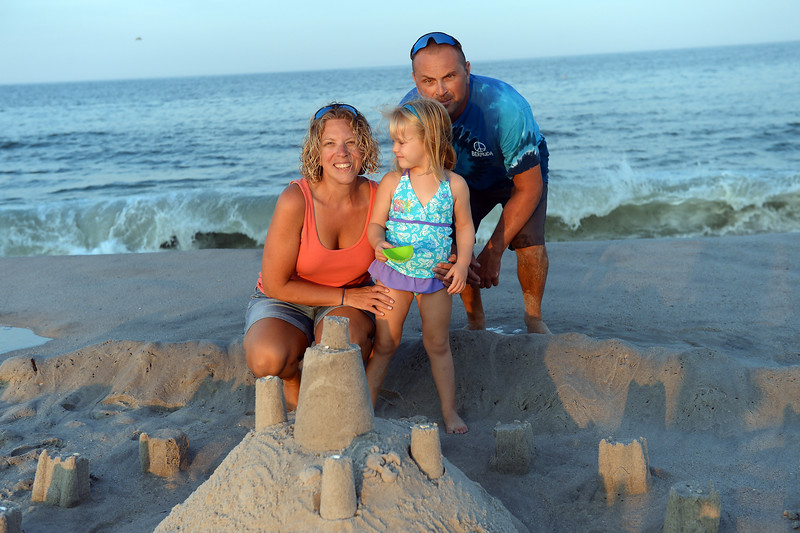 Noelle, Samantha, and Keith Newman in front of their sand castle creation at the Kites and Castles event on the beach, in Lavallette, NJ on 08/01/2019.