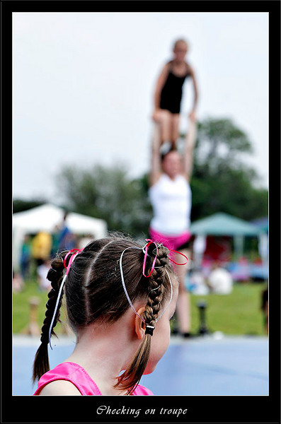 Young member of the gymnastic team watching her friends (80566212).jpg