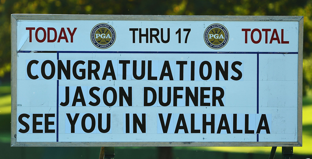 . A score board with a message congratulating Jason Dufner of the United States after his two-stroke victory at the 95th PGA Championship at Oak Hill Country Club on August 11, 2013 in Rochester, New York.  (Photo by Stuart Franklin/Getty Images)