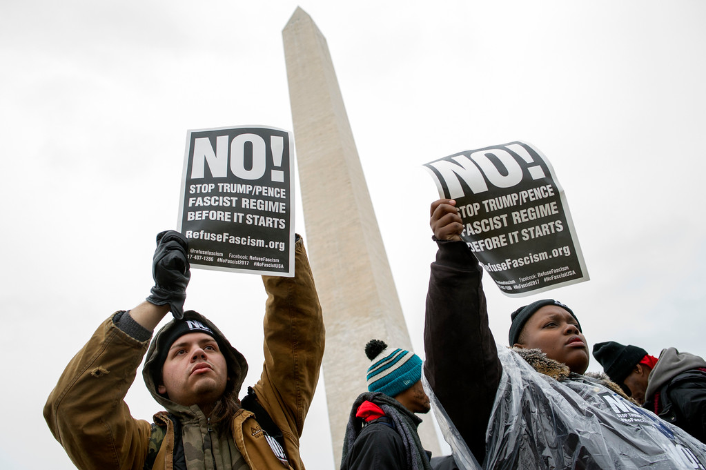 . Civil rights advocates demonstrate on the Washington Monument grounds before marching to honor the Rev. Martin Luther King, Jr. in Washington, Saturday, Jan. 14, 2017.  (AP Photo/Cliff Owen)