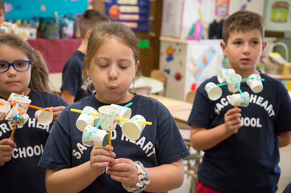 10/17/19 Wesley Bunnell | StaffrrStudents in Mrs. Kerr's class at Sacred Heart School show their anemometers they built as part of a science experiment on Thursday October 17, 2019.