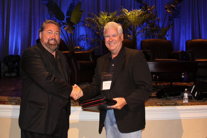 """""""Your Turn: The Next Five Years: A Group Conversation"""": Mark Anderson, SNS CEO and FiRe Chair, presents a gift of appreciation to FiReSpotter Rick LeFaivre, Venture Partner, OVP Venture Partners"""