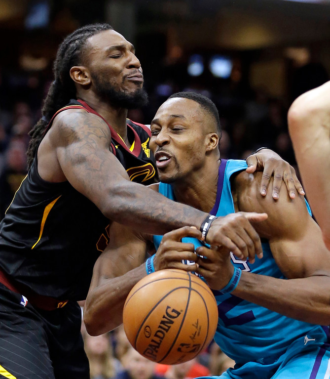 . Cleveland Cavaliers\' Jae Crowder, left, fouls Charlotte Hornets\' Dwight Howard (12) in the second half of an NBA basketball game, Friday, Nov. 24, 2017, in Cleveland. (AP Photo/Tony Dejak)