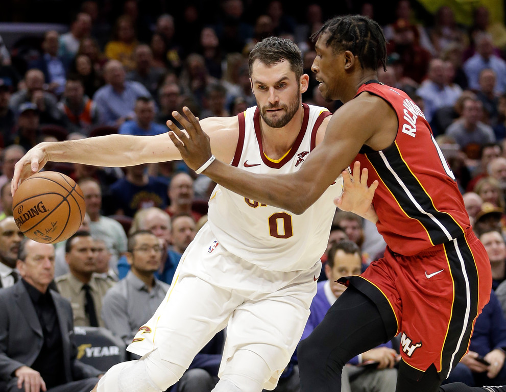 . Cleveland Cavaliers\' Kevin Love, left, drive past Miami Heat\'s Josh Richardson in the first half of an NBA basketball game, Tuesday, Nov. 28, 2017, in Cleveland. (AP Photo/Tony Dejak)