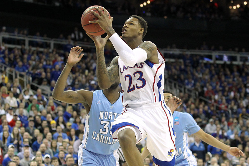 . Ben McLemore #23 of the Kansas Jayhawks drives for a shot attempt in the first half against Reggie Bullock #35 of the North Carolina Tar Heels during the third round of the 2013 NCAA Men\'s Basketball Tournament at Sprint Center on March 24, 2013 in Kansas City, Missouri.  (Photo by Ed Zurga/Getty Images)