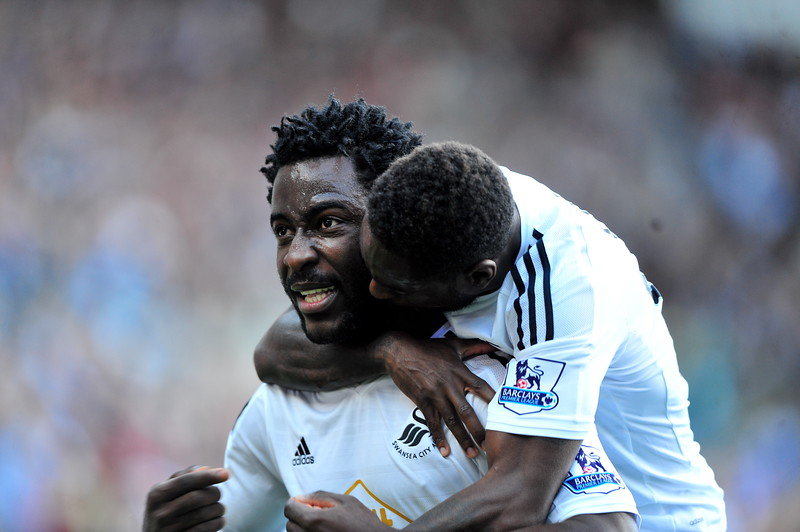 SPORT.... SWANS v NEWCASTLE.... Saturday 4th OCTOBER 2014 Action from Swansea City v Newcastle United. Pictured - Wilfried Bony celebrating his goal.