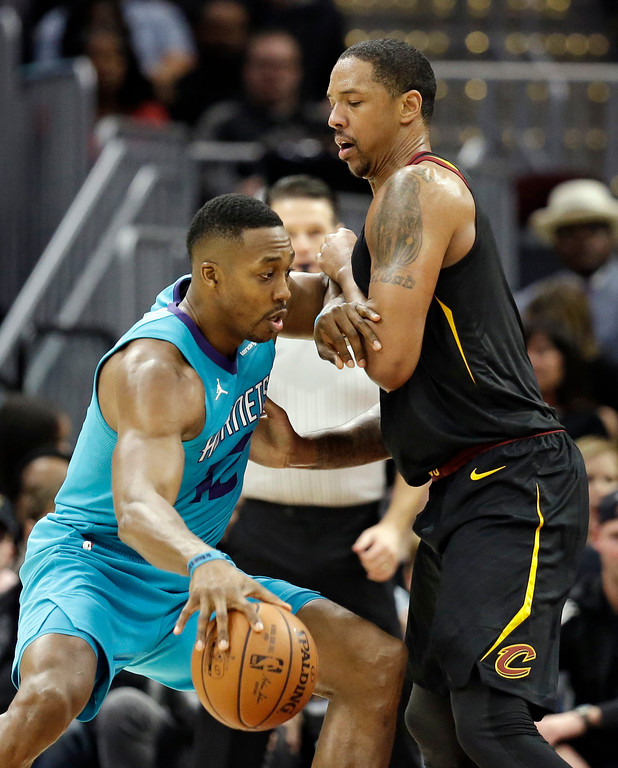 . Charlotte Hornets\' Dwight Howard, left, drives past Cleveland Cavaliers\' Channing Frye in the first half of an NBA basketball game, Friday, Nov. 24, 2017, in Cleveland. (AP Photo/Tony Dejak)