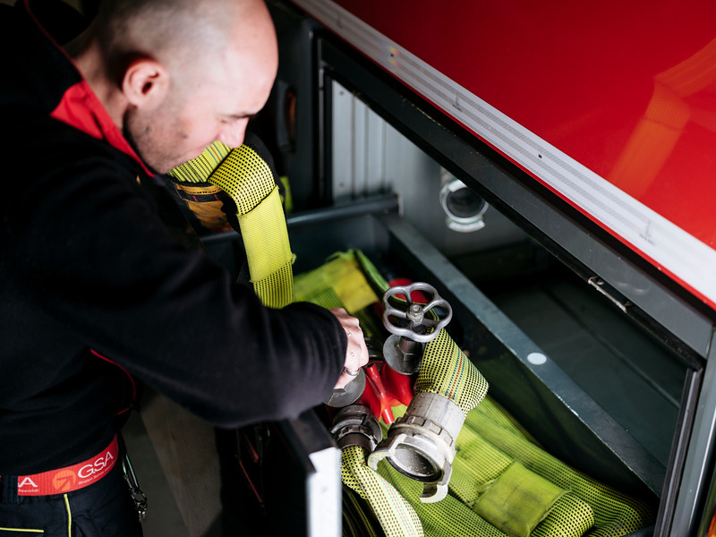 Simone Vesan direct response crew (professional firefighters) checking the equipment of the Proteus truck in the hangar on the French side - Samuel Zeller for the New York Times