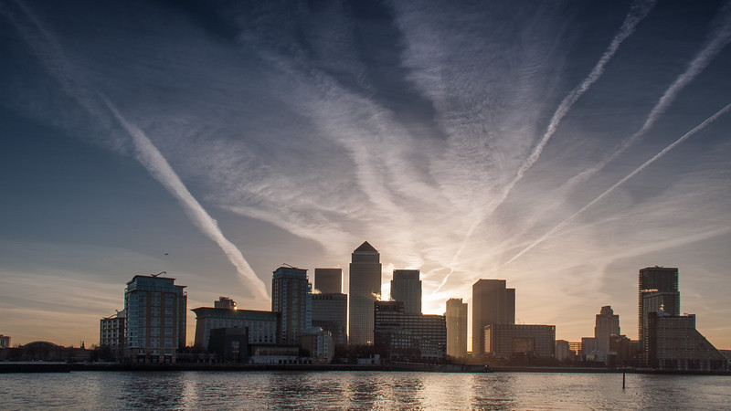 Sunrise behind the skyscrapers of London Docklands