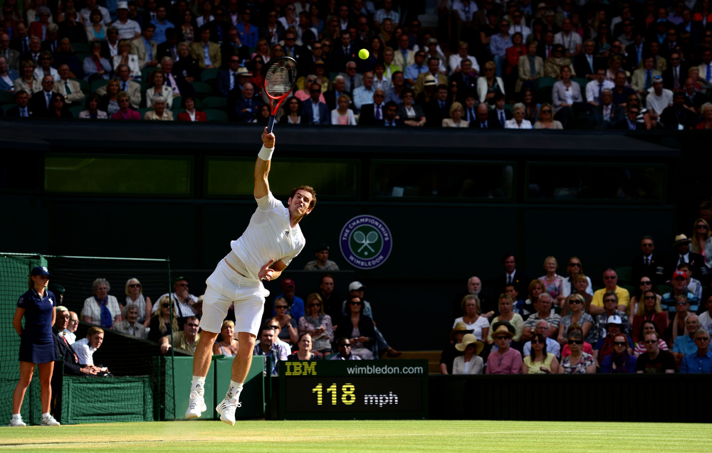 . Andy Murray of Great Britain serves during the Gentlemen\'s Singles fourth round match against Mikhail Youzhny of Russia on day seven of the Wimbledon Lawn Tennis Championships at the All England Lawn Tennis and Croquet Club on July 1, 2013 in London, England.  (Photo by Mike Hewitt/Getty Images)