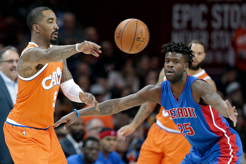 . Cleveland Cavaliers\' J.R. Smith (5) passes against Detroit Pistons\' Reggie Bullock (25) in the second half of an NBA basketball game, Tuesday, March 14, 2017, in Cleveland. (AP Photo/Tony Dejak)