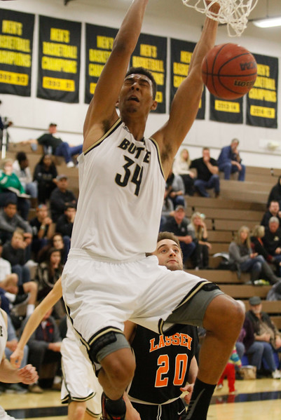 Butte College's Andrew Whitsett dunks leaving Lassen's Max Denham (20) in his dust during a men's basketball game February 15, 2017 at Butte College in Oroville, California. (Emily Bertolino -- Enterprise-Record)